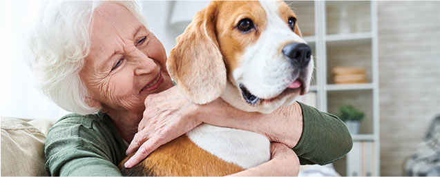 Elderly Woman Hugging Her Hound Dog